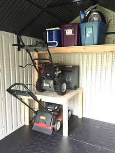 I think the lawnmower would be easier to put on the top shelf