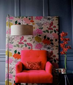 wrap a large piece of plywood in a fun fabric and prop it against the wall or frame a favorite fabric...a great way to add interest to a plain wall!