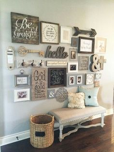 Family photo gallery wall with monogram and other wall art.