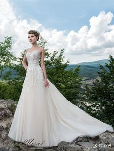 We Offer A Range Of Designer Gowns From Elena Morar Amore Novias And Dianelli As