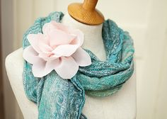 A tutorial on how to make a fabric flower.