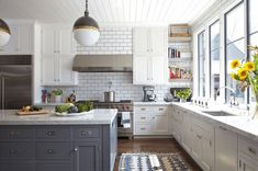 White With Blue/grey Island - Contrast white cabinets and counters with a colored island