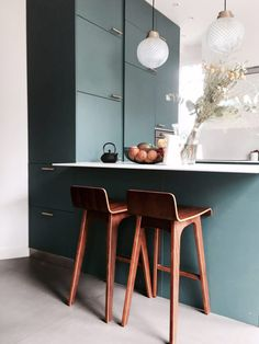 modern kitchen with blue green cabinetry and brass pulls. / sfgirlbybay