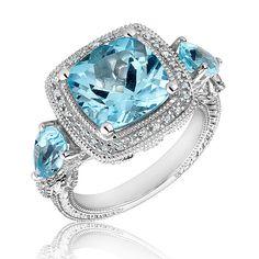 REEDS Jewelers ~ Roberta Z Blue Topaz and Diamond Ring 1/5ctw
