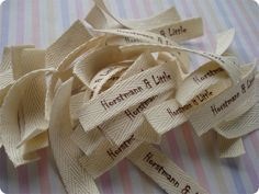 Make lables from twill ribbon and printable heat transfer. Genius!!