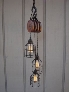From the mountains of upstate New York, pulley number 5... They've incorporated this gorgeous vintage farm pulley into this rustic industrial style lightin