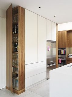 Wood end cabinet, added to a standard white IKEA kitchen could give it a custom look, similar to this inspirational images.  Cuisine blanche avec panneaux imitation bois