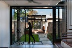Internal courtyard links both parts of the house with sleek, bi-fold doors.