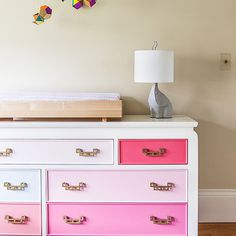 Vintage dresser given a pretty in pink color blocking treatment along with new hardware | Design by Chloe Warner and originally featured in Lonny