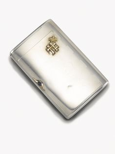 An Imperial Presentation Fabergé silver cigarette case, workmaster Anders Nevalainen, St Petersburg, circa 1890 plain polished surface, the lid applied with the gilt cypher of Grand Duke George Mikhailovich (1863-1919), the end with vesta compartment, cabochon sapphire thumbpiece, struck with workmaster's initials and 88 standard, scratched inventory number 4975, in original Fabergé wood case