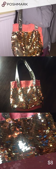 Sequined Orange and Gold Tote Bag This is a sequined canvas tote great for every day use! Why not have a little bling in your day! The straps are cloth and have a golden snakeskin design. The bad itself is orange with gold sequins. There is a magnetic snap closure. As seen in the pictures, there is one area missing a few sequins, other than that, this is a great bag! Justice Bags Totes