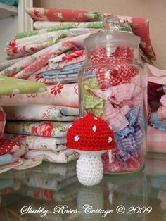 So simple yet so cute - glass jar with pretty fabric in it. I *must* do this in my sewing room!