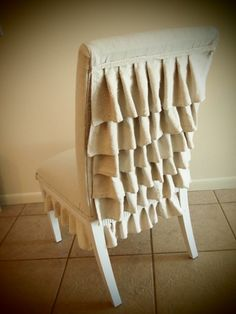 Recently made a slipcover for my sewing machine chair ... may have to add ruffles!