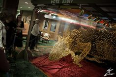 Suspended Dragon Made of 40,000 Golden Buttons by Robin Protz