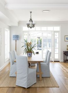 Dining room with french doors, I love the blue light shade,