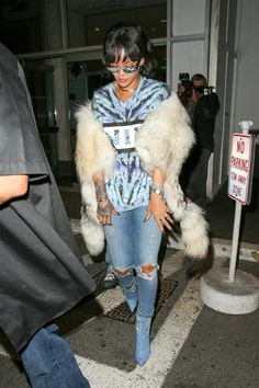Rihanna wearing Chopard Onyx White Diamond and Rose Gold Happy Hearts Bracelet, Chopard Happy Hearts Coral Bracelet, Jacquie Aiche Cameo Ring, Chopard Mother of Pearl and Rose Gold Happy Hearts Bracelet, Manolo Blahnik Dancehall Cowgirl Jewel Boots, Rihanna x Dior Sunglasses in Silver, Dennis Basso Fall 2016 Fur, Chopard Turquoise Happy Hearts Bracelet, Nine Inch Nails Tie Dye T-Shirt and Citizens of Humanity Rocket Jeans in Distressed Fizzle