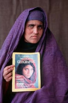 "National Geographic Magazine - Sharbat Gula ""The Afgan Girl"" was found 17 years later after the photo taken of her as a little girl in the refugee camps. Photographed by Steve McCurry"