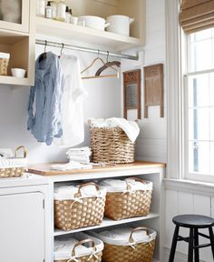 Once a tiny bedroom, the laundry room in this Mississippi home houses the owner's grandmother's washboards. The baskets are from Kmart and World Market.