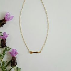 """Gold Tone Dainty Arrow Necklace Small, pretty arrow necklace. Bright gold color. Length is 16"""", but can be extended with clasp. Pendant is 1 1/4"""" Farah Jewelry Jewelry Necklaces"""