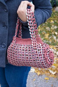 This handbag is soooo cool! Just look at the material which has been used to make it.   http://www.etsy.com/listing/88470649/upcycled-mauve-crochet-pop-tab-hand-bag