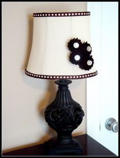 "though this is not the cutest, i like the idea of ribbon and flowers to bring new ""light"" to an old lamp shade!"