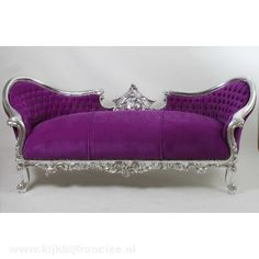 .Royal purple couch
