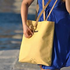 Spacious , water resistant, interior and exterior pockets, Minimal. Our Reversible Tote is all that it promise to be and even more!!!