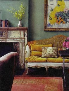 The aged paint on the fireplace is fantastic as are the colours, flowers & furniture.