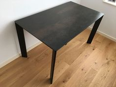 Link premium ceramic top extendable dining table with black matt steel frame. Delivered to our client in London.