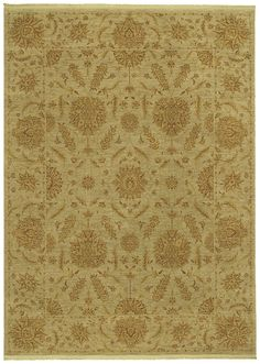 Add some extra cozy to your fireplace room with a large area rug, like this soft golden yellow one from Shaw.