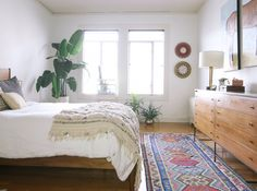 Add a colorful rug to provide a minimal space extra umph