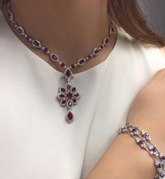 ChristiesJewelsOnline sale The model is wearing Lots 58 (Ruby and diamond pendant necklace) and 60 (Ruby and diamond bracelet)