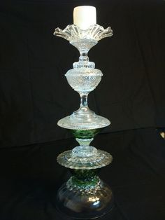24-inch candle holder made with re-purposed glass.  www.recreationsinglass.etsy.com  SOLD