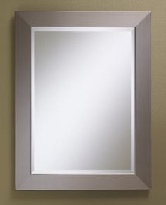 "254 – Mirror features a ""Faux Stainless Steel"" (non-metal) finish on a solid wood frame with 1″ beveled edge mirror. 25 1/2″ wide, 33 1/2″ high and 1″ deep…"