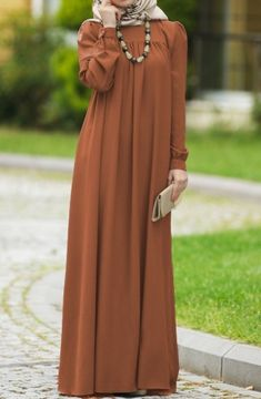 Suhneva Tesettür Robalı Elbise Modelleri Garments from girls's beloved bits of attire might be the important thing to a particular … Abaya Fashion, Muslim Fashion, Modest Fashion, Fashion Art, Fashion Clothes, Fashion Dresses, Hijab Evening Dress, Hijab Dress, Mode Abaya