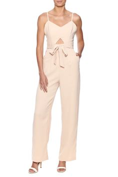 Beige jumpsuit with sweetheart neckline and small cut out in front. Hidden zipper closure and belt tie around waist.  Beige Jumpsuit by Next Boutique . Clothing - Jumpsuits & Rompers - Jumpsuits New York City New York