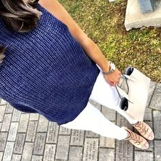 IG @mrscasual <click through to shop this look> Navy blue sleeveless turtleneck sweater.  White skinny jeans.  Lace up heeled sandals.  Street level tote.