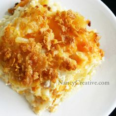 Cheesy Hash Brown Casserol: 2 lbs shredded hash browns, 3/4 cup (1.5 sticks) butter (divided, melted), 1 can cream of chicken (or celery) soup, 1/2 cup diced onion, salt pepper and garlic powder, 2 cups shredded sharp cheddar cheese, 1 pint (2cups) sour cream, 2 cups corn flake cereal for topping. 9x13 sprayed baking dish, 350* until browned