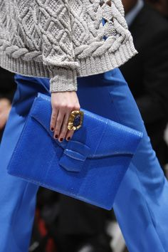 blue clutch, amazing ring.  oscar de la renta