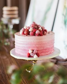 Step+away+from+classic+chocolate+cake+with+a+pretty+ombré+raspberry+buttercream+topped+with+a+pile+of+fresh+berries+courtesy+of+Cake+Life+Bake+Shop.