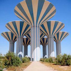 stripes of a different stripe   Kuwait Water Towers, designed by Sune Lindström  photo by Mohammad Abdullah  .  .  .  .  .  #kuwait #watertower #architecture #sunelindstrom #archilovers #archidaily #stripes #desert #kellybehun #kellybehunstudio