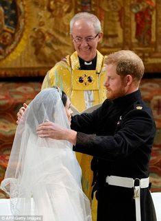 Proud groom Prince Harry was emotional during the ceremony as he lifted his bride's veil...