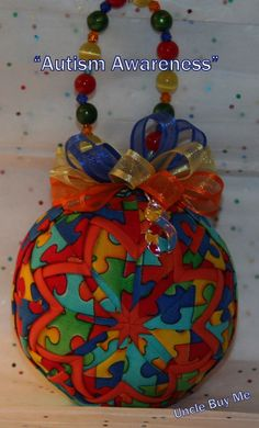 Quilted Ornaments Quilt Ball Ornaments Autism Awareness Puzzle Pieces with Handmade Beaded Hanger and Matching Charm. $22.00, via Etsy.