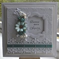 Stunning card made with die cuts, embossing and 3D flowers