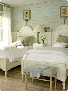love the stacked plank wall and I'm a sucker for twin beds in the guest room