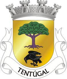 """Brasão de armas de Tentúgal - Official blazon  Escudo de ouro, pinheiro arrancado de púrpura, folhado de verde, em campanha, um corvo de negro, animado de vermelho e realçado de prata. Coroa mural de prata de quatro torres. Listel branco, com a legenda a negro: """" TENTÚGAL """". TENTÚGAL  Municipality : Montemor-o-Velho District : Coimbra"""