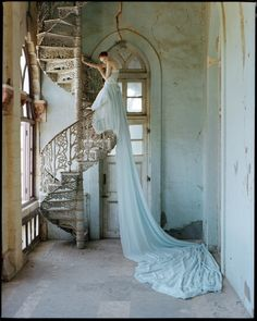 Tim Walker Photography. Lily and spiral staircase. Whadwhan, Gujarat, India, 2005.
