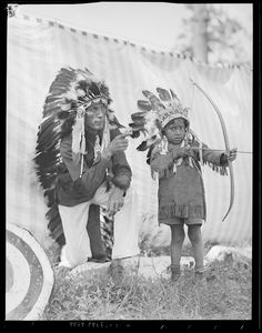Indian teaching young brave the art of the bow and arrow by Boston Public Library, via Flickr