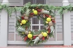 Christmas in Colonial Williamsburg, 2012: Wreath with 3 kinds of apples (lady apples, pineapples, & hedge apples) More: http://twonerdyhistorygirls.blogspot.com/2012/12/day-iv-christmas-in-colonial.html