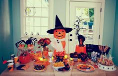 Themed Halloween Table settings-- Two Gothic and one cute.